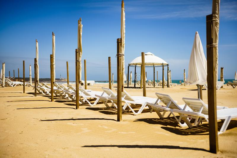 Algarve, Portugal, a stunning sea ocean landscape with sunbeds and umbrella. royalty free stock images
