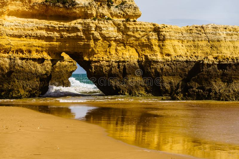 Algarve, Portugal, a stunning sea ocean landscape with yellow rocks and azure water. stock photo