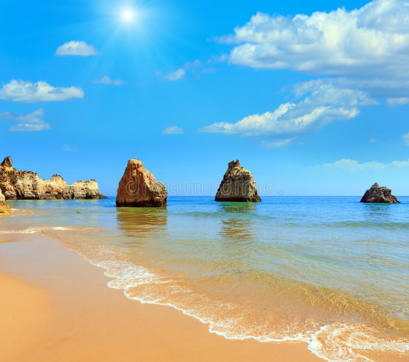 Algarve sunshiny beach Dos Tres Irmaos Portugal. Sandy beach Dos Tres Irmaos summer sunshiny view with blue cloudy sky Portimao, Alvor, Algarve, Portugal stock photography