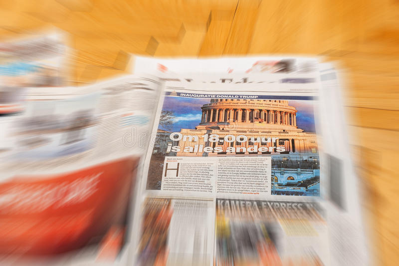 Algemeen Dagblad Dutch magazine above major international newspaper. PARIS, FRANCE - JAN 21, 2017: Algemeen Dagblad Dutch magazine above major international stock image