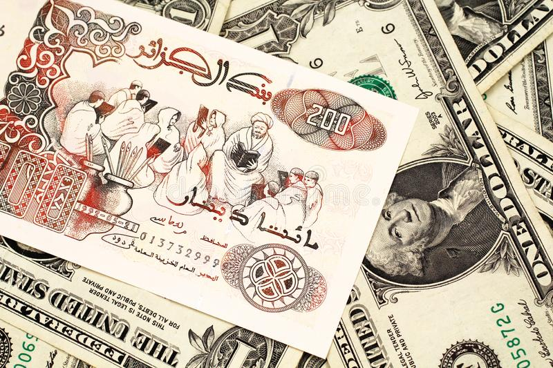 An Algerian dinar note with American one dollar bills royalty free stock photos