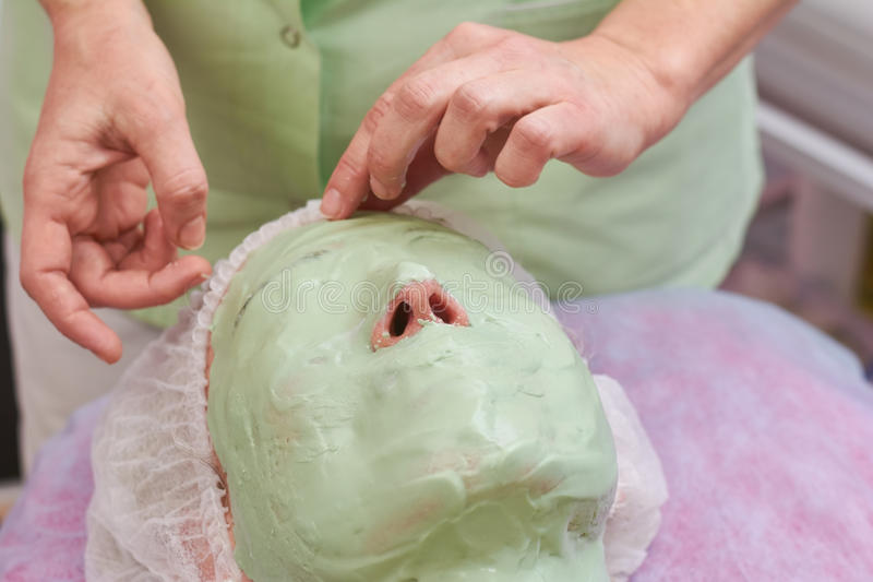 Alginate face mask close up. Person at the cosmetician stock photo