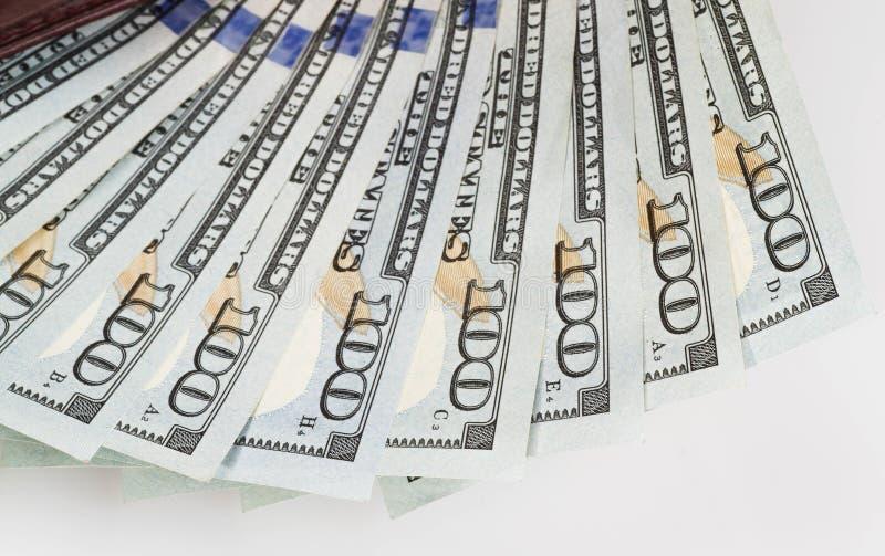 Algumas cem notas de dólar em uma carteira imagens de stock royalty free