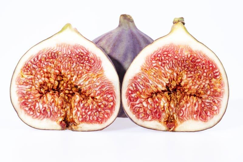 Algunas frutas de los higos frescos aislados en el fondo blanco fotos de archivo