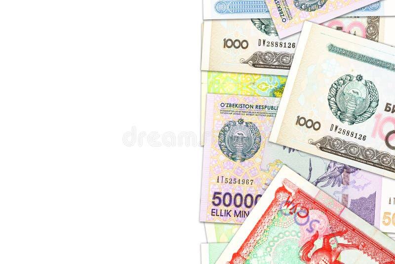 Algunos billetes de banco del som del Uzbek que indican economía cada vez mayor con el copyspace fotografía de archivo libre de regalías
