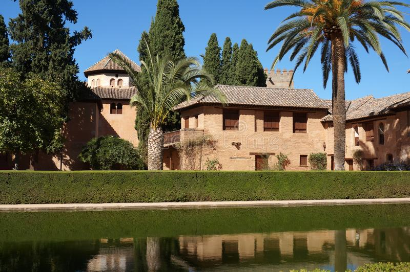 Alhambra Architecture, Water and Trees in Granada Spain. Photo alhambra architecture with water and trees in granada spain in europe