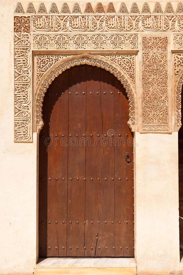 Alhambra de Granada: Moorish ornated door. In the Court of the Mirtles (Patio de Arrayanes royalty free stock photography