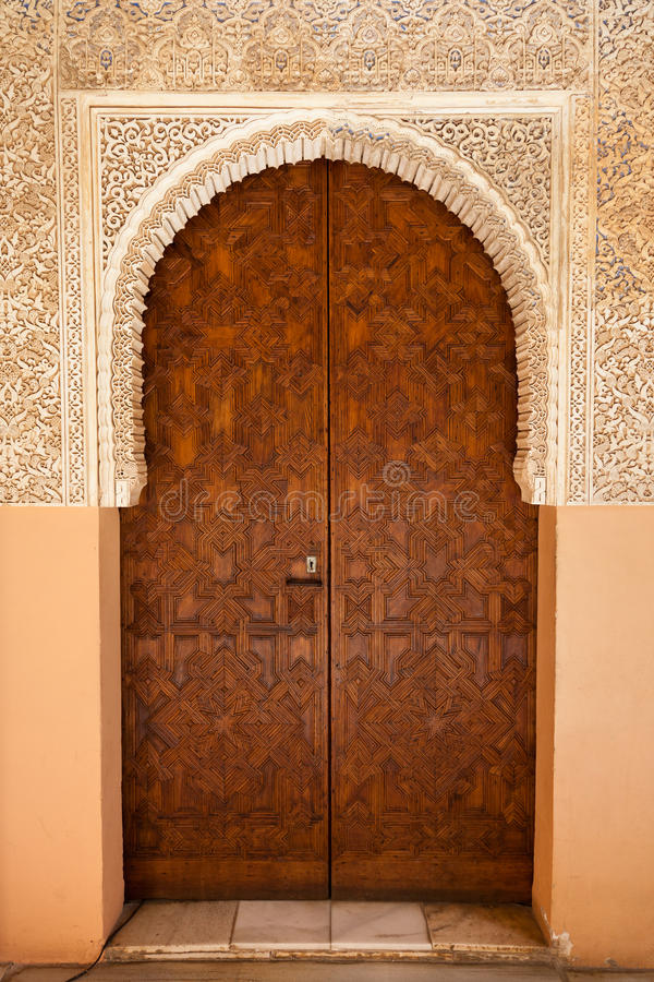 Alhambra de Granada: Moorish ornated door. In the Court of the Lions (Patio de los leones royalty free stock photo