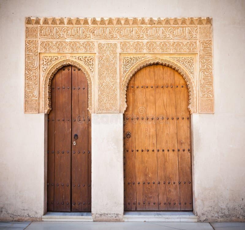 Alhambra de Granada: Moorish ornated doors. In the Court of the Mirtles (Patio de Arrayanes stock photo