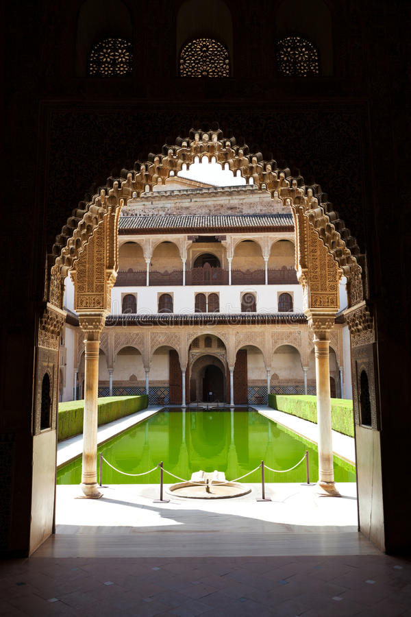 Alhambra de Granada: Patio de Arrayanes. The Court of the Myrtles seen trough a moorish door royalty free stock photos