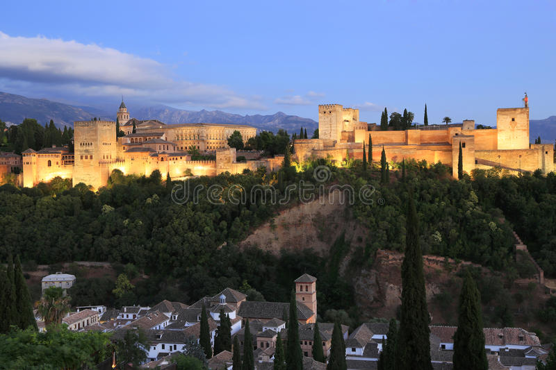 Alhambra Palace illuminated at dusk, Spain. Night photo of the Alhambra Palace, in Granada, Andalusia, Spain. A monument icon, the most visited in Spain royalty free stock photos