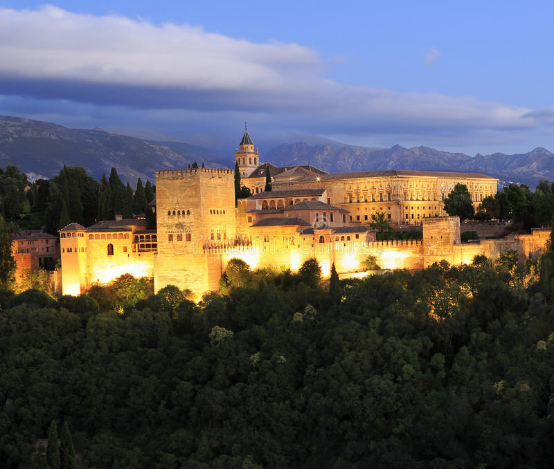 Alhambra Palace illuminated at dusk, Spain. Night photo of the Alhambra Palace, in Granada, Andalusia, Spain. A monument icon, the most visited in Spain royalty free stock photography