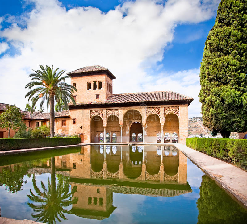 Alhambra palace reflected in water in Granada. Spain. Torre de las Damas in the Alhambra of Granada in Granada. Spain stock photo