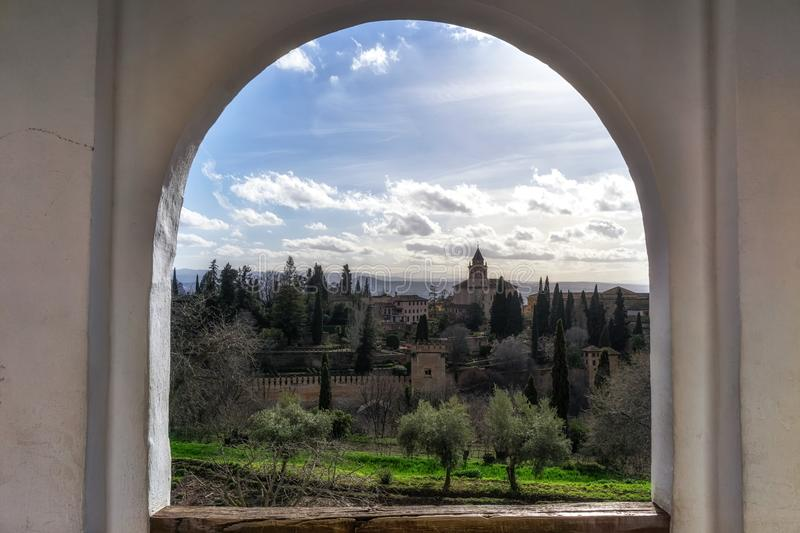 Alhambra palace view from generalife. Alhambra palace viewed from Generalife mansion windows. Granada, Spain royalty free stock image