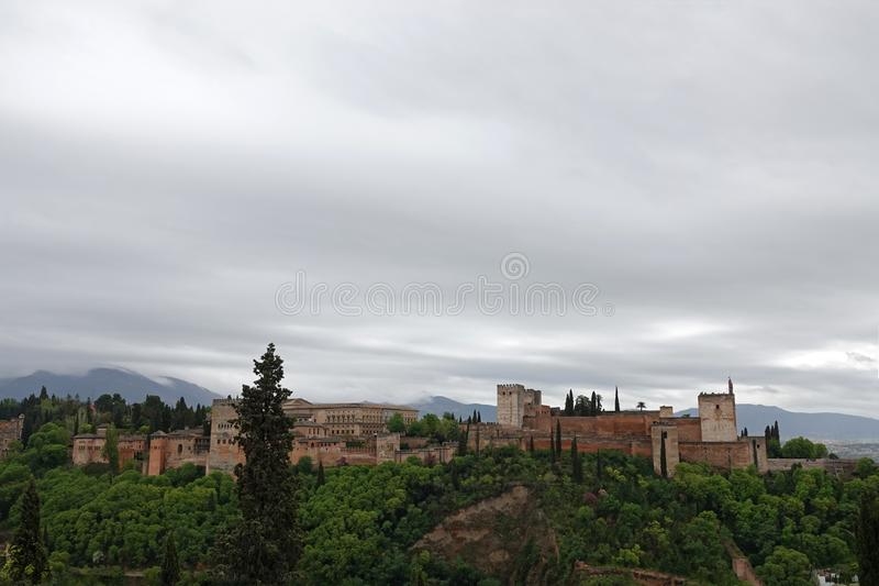 The Alhambra palaces in Granada, Andalusia. The moorish complex Alhambra is located on top of the hill al-Sabika, on the left bank of the river Darro, to the stock photo