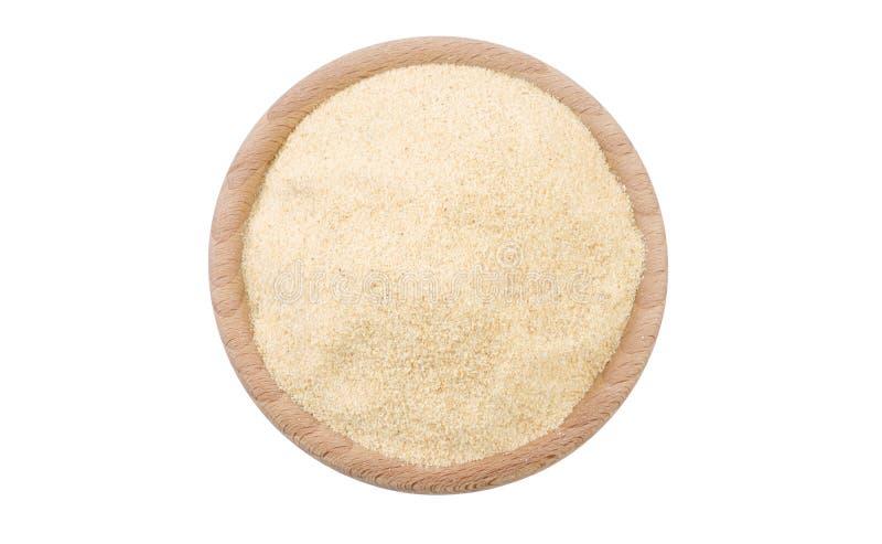 Alho à terra moído secado na bacia de madeira isolada no fundo branco Especiarias e ingredientes de alimento fotografia de stock