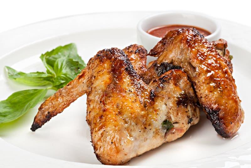 Ali di pollo arrostite con salsa al pomodoro immagine stock libera da diritti