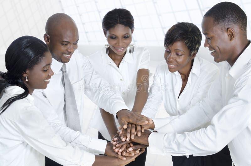 Alianza africana del equipo del negocio foto de archivo