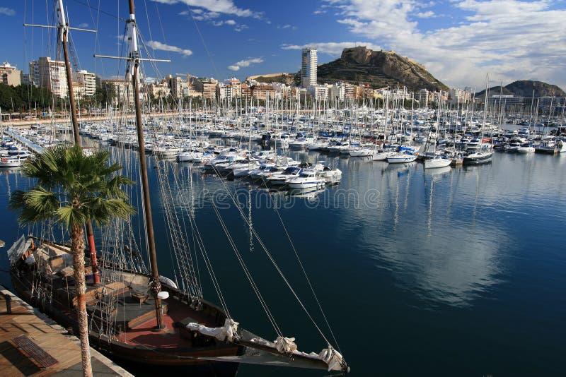 Alicante port. Port and fortress of Santa Barbara behind Marina Alicante stock photos