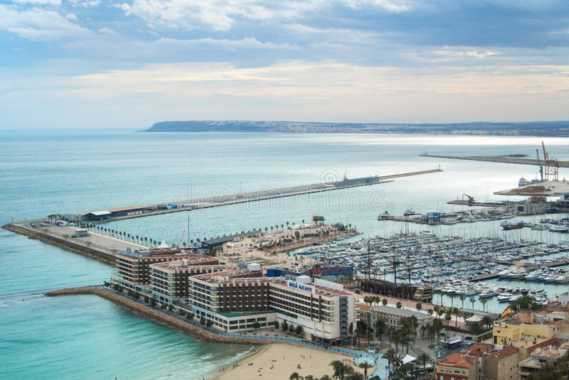 ALICANTE, SPAIN - FEBRUARY 12, 2016: A view from Santa Barbara Castle to a port of the city with a plenty of yachts stock photos