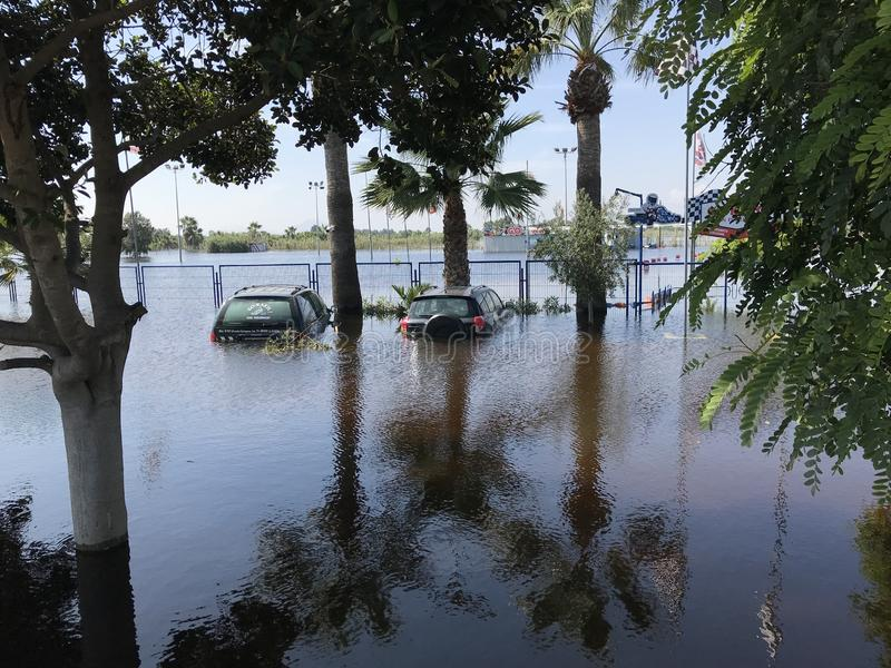 Flooded Cars in the Parking Road. Deep Waters. Flooding Nature After Heavy Rainy Day. Global Warming. royalty free stock photos