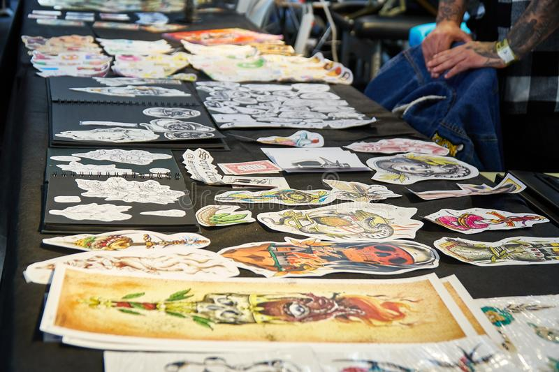 ALICANTE TATTOO FAIR CIRCA 2018 tattoo designs and samples. In a convention stock photography
