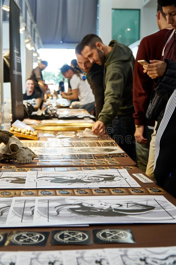 ALICANTE TATTOO FAIR CIRCA 2018 tattoo exibition with some artist. And merchandising stock photo