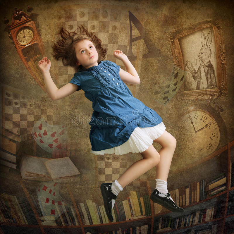 Alice falling down. The rabbit hole stock photo