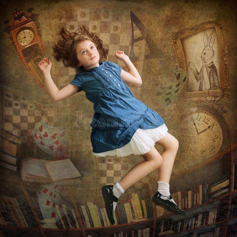 Alice que cai para baixo foto de stock