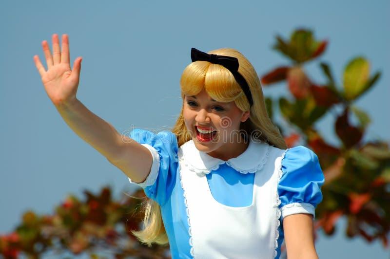 Alice in wonderland. Fairytale character alice of the wonderland at disneyland, hong kong, greeting teh visitors royalty free stock photography