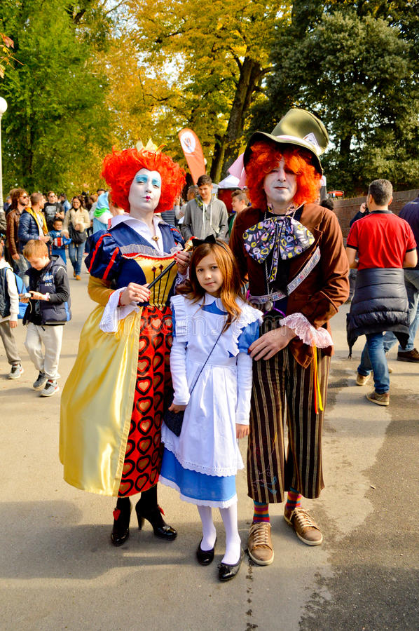 Alice in Wonderland Cosplayers at Lucca Comics and Games 2014. Tim Burton's Alice in Wonderland cosplayers during the Lucca Comics and Games 2014 festival. Lucca stock image