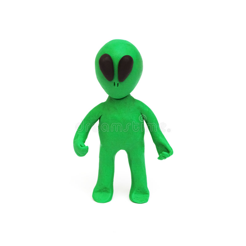 Alien, clay modeling. A green alien made from clay royalty free stock photos