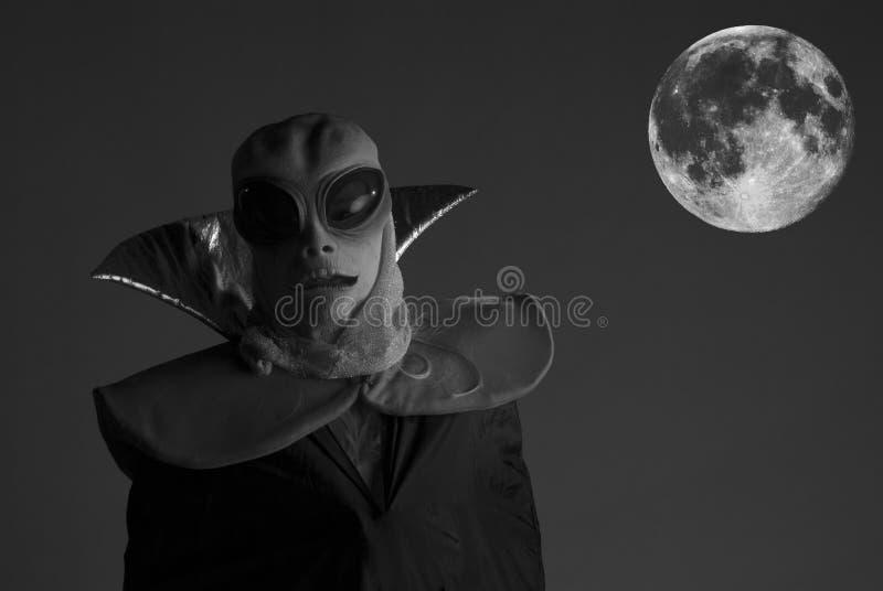 Alien in full moon. Alien visitor in full moon. Black & White photo stock photography