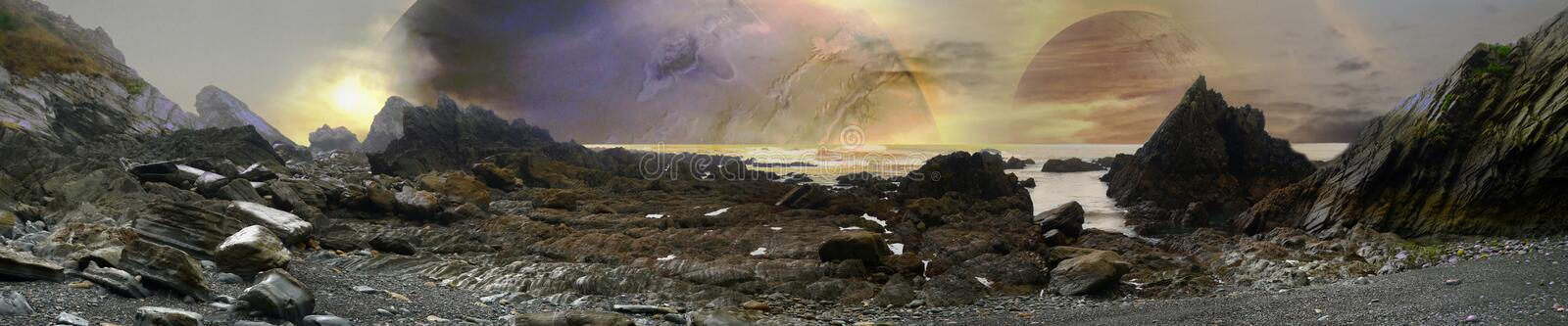 Alien landscape with planets and rocky beach stock image