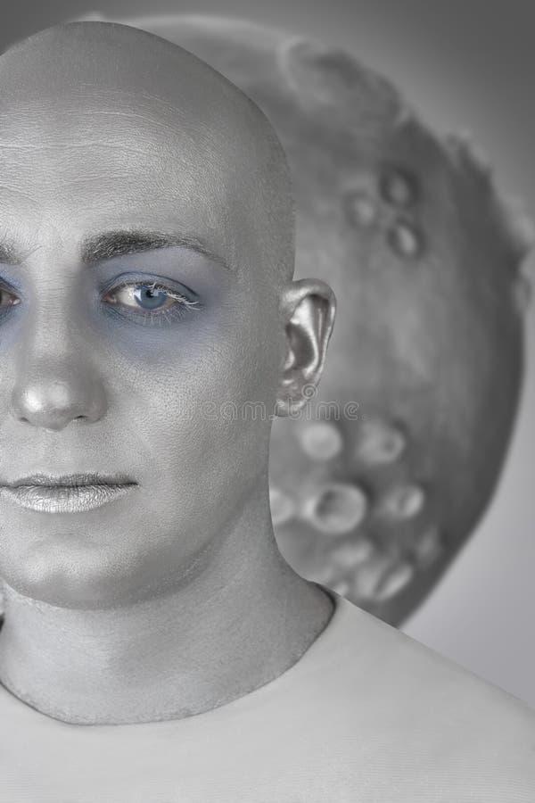 Alien man futuristic silver skin extraterrestrial. Alien man portrait futuristic silver skin extraterrestrial space metaphor stock image