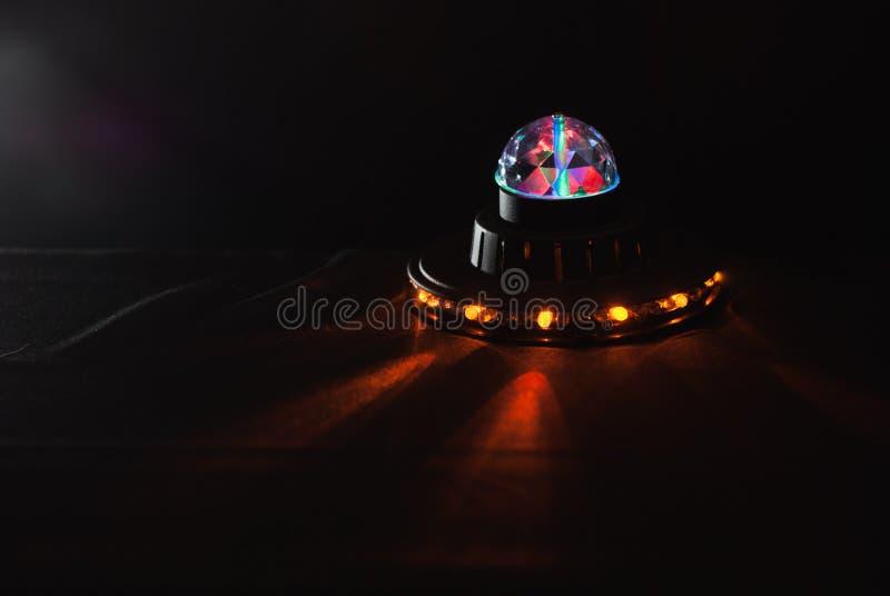 Alien spaceship , glow UFO, children`s lamp,. Bright light royalty free stock photos