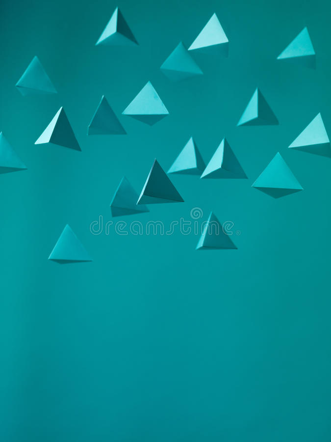 Aliens. Abstract blue paper pyramid background in space. Copy space available. Usefull for business cards and web stock image