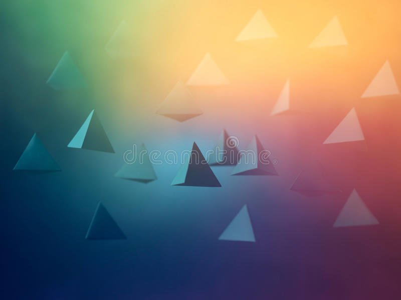 Aliens. Colorful abstract paper pyramid background in space. Copy space available. Usefull for business cards and web royalty free stock photography