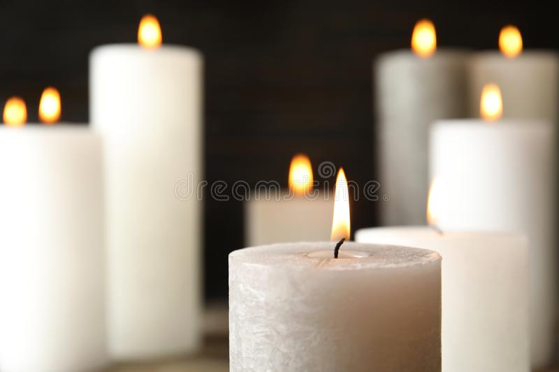 Alight wax candle on blurred background, closeup. Space for text royalty free stock photo