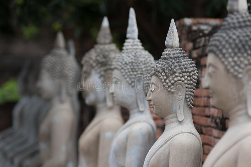 The Pagoda and Buddha Status at Wat Yai Chaimongkol, Ayutthaya,. Aligned Sitting Buddha Statues and Buddha Status at Wat Yai Chaimongkol, Ayutthaya, Thailand stock photo