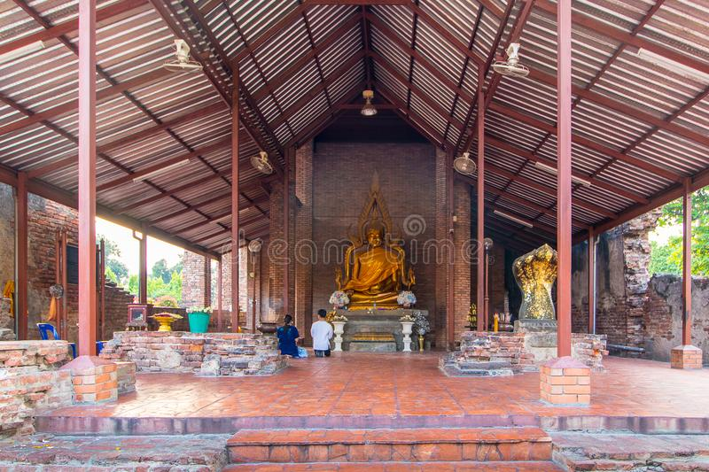 The Pagoda and Buddha Status at Wat Yai Chaimongkol, Ayutthaya,. Aligned Sitting Buddha Statues and Buddha Status at Wat Yai Chaimongkol, Ayutthaya, Thailand stock photos
