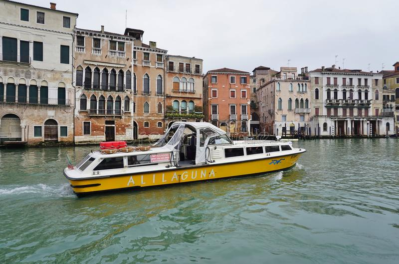 An Alilaguna water taxi vaporetto on the Grand Canal royalty free stock image