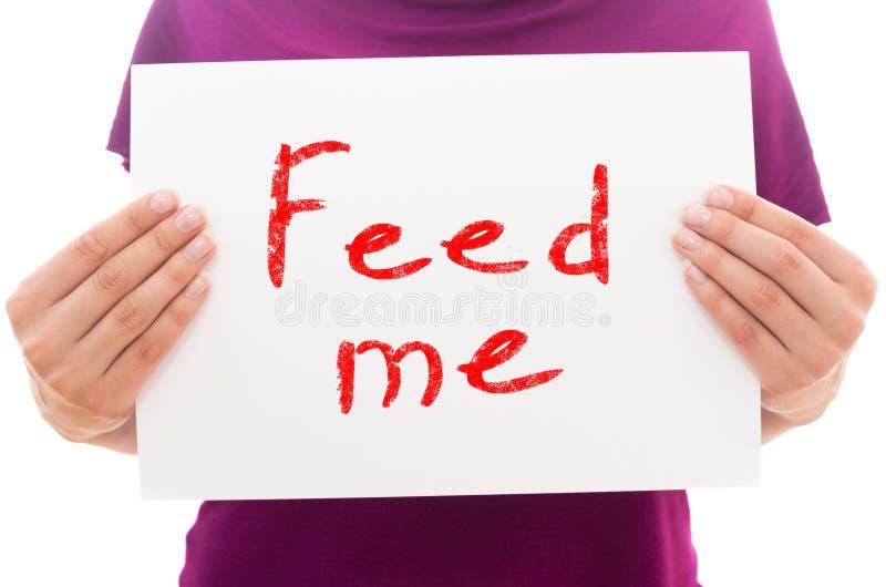 Alimentimi immagine stock