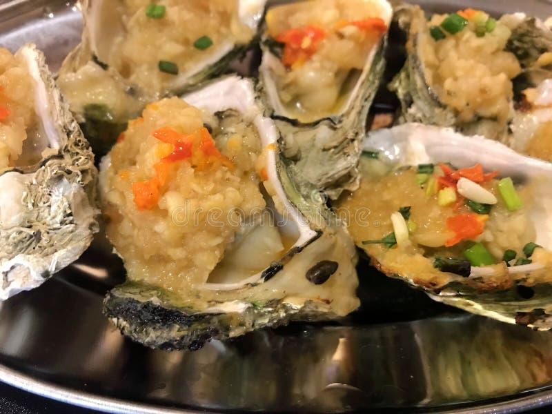 Alimento chinês grelhado da culinária do marisco da ostra foto de stock
