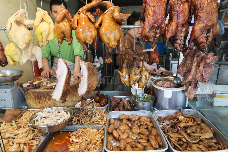 Alimento cinese della carne a di macelleria nella porcellana del mercato di strada di Macao fotografie stock libere da diritti