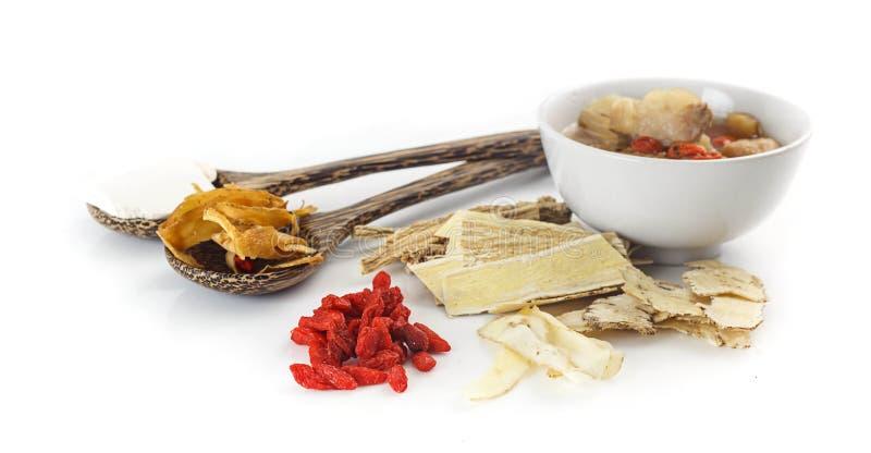 Alimento cinese - minestra pura con medicina di erbe cinese fotografia stock