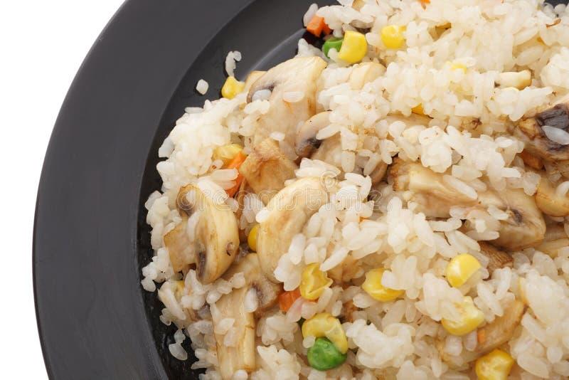 Alimento cinese Riso con i funghi e le verdure immagine stock