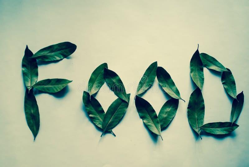 Alimento da palavra Folhas do louro Filtro verde imagem de stock royalty free