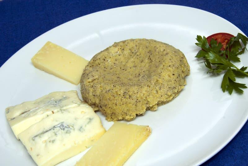 Alimento de Italina - Polenta y queso imagen de archivo