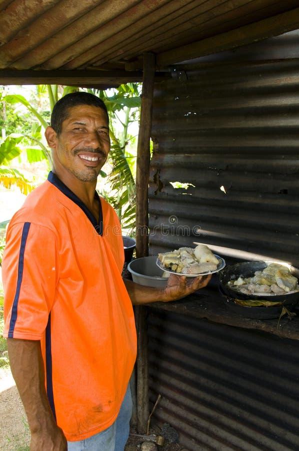 Alimento de la reducción del rondon de los mariscos del hombre de Nicaragua imagenes de archivo